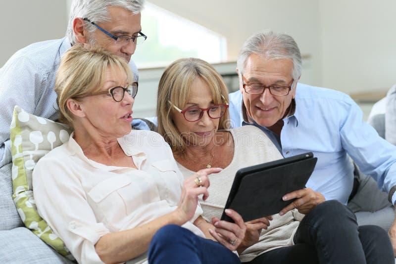 Modern seniors using new technology having fun stock images