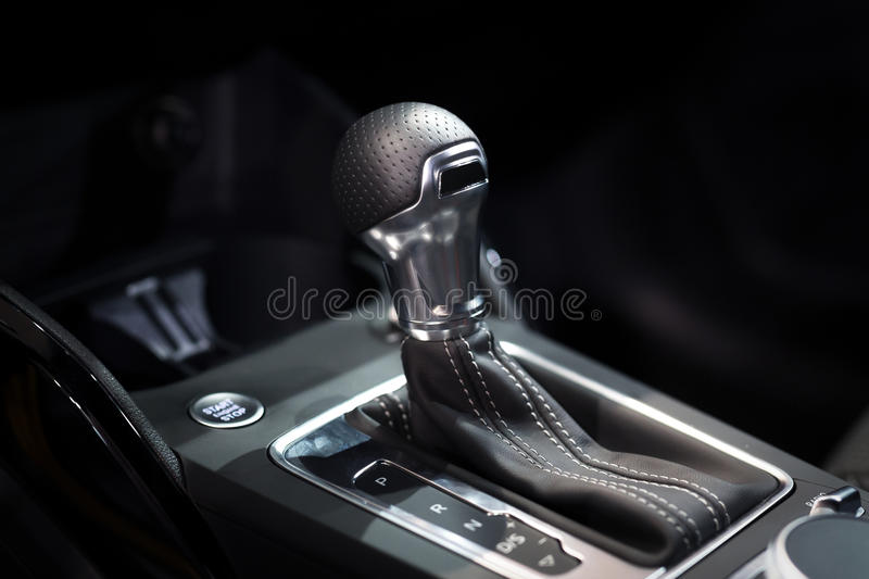 Modern shift gear in luxury car interior stock photography