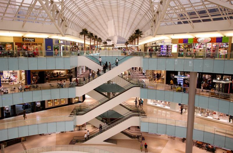 Modern Upscale Shopping Mall. Dallas, TX, May, 2016: Modern retail shopping mall with upscale stores in an American city, multi-level. Not very crowded, economy royalty free stock images
