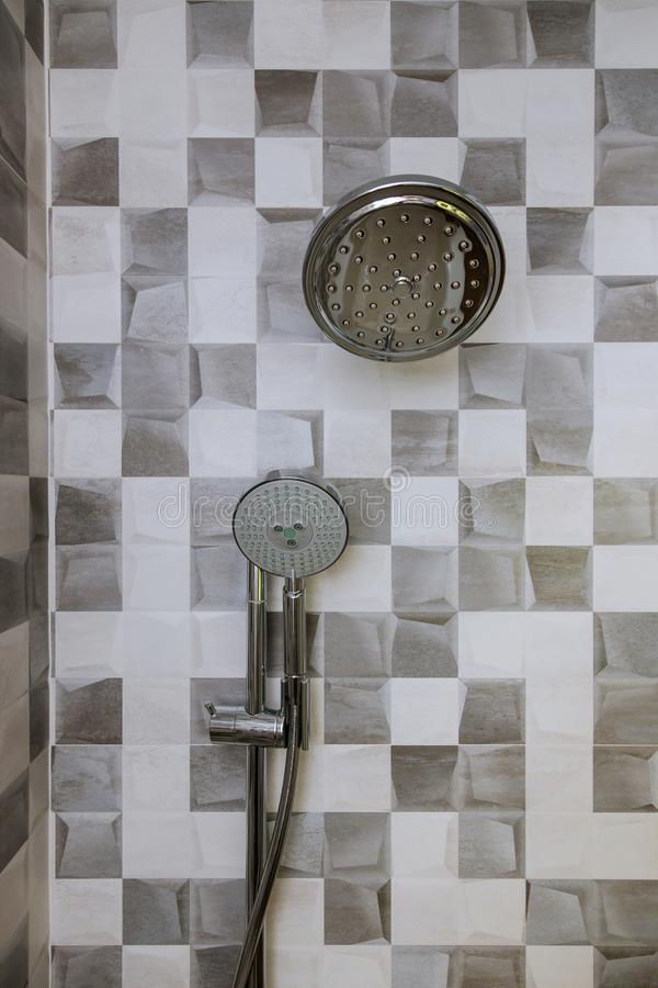 Modern shower head in bathroom with new home construction stock photography