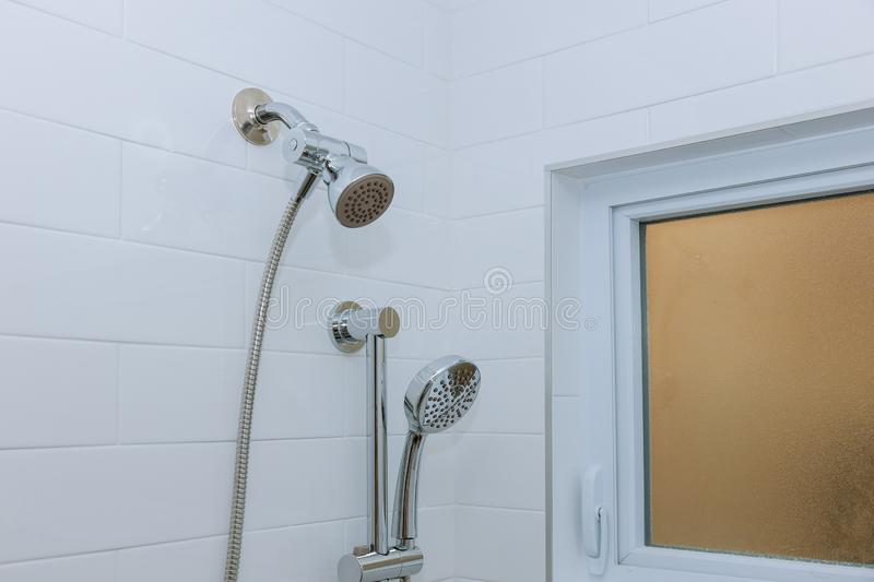 Modern shower head in bathroom with new home construction stock image