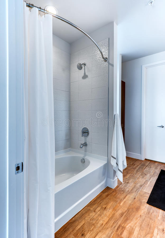Modern shower at hotel resort. Modern shower and fixture in bathroom of upscale hotel resort stock image