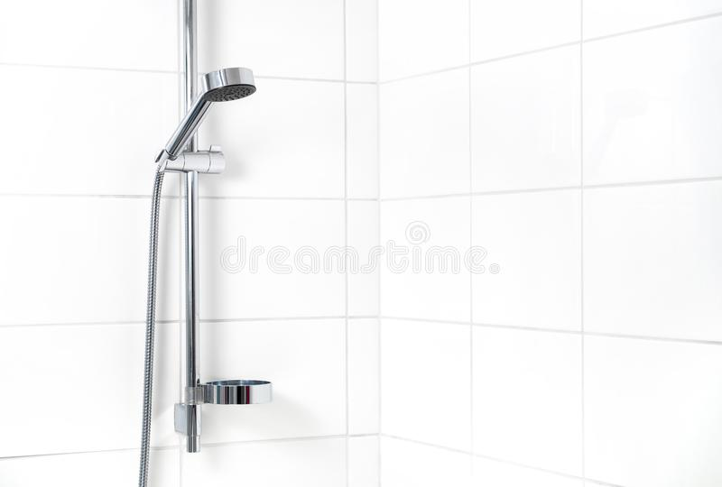 Modern shower with white wall tiles. royalty free stock photography
