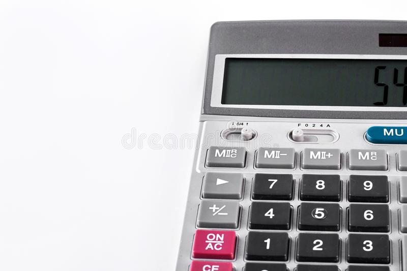 Modern silver calculator, white background. royalty free stock photo