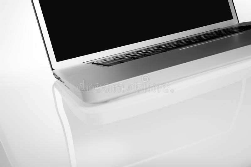 Modern silver laptop on white background royalty free stock images