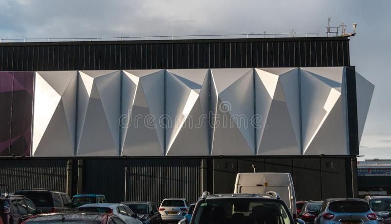 The modern, silver NEC Arena building. Part of a the modern, silver NEC Arena building royalty free stock image