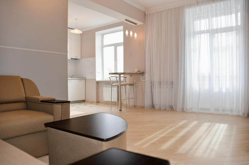 Modern, simple interior in light apartments. Modern, simple interior design in light apartments royalty free stock image