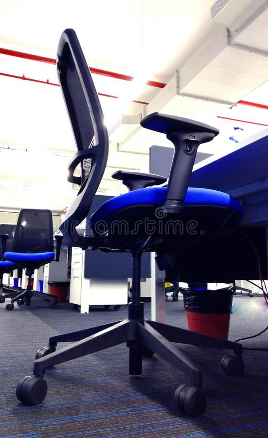 Modern chair row of the work station an information technology company. royalty free stock photography