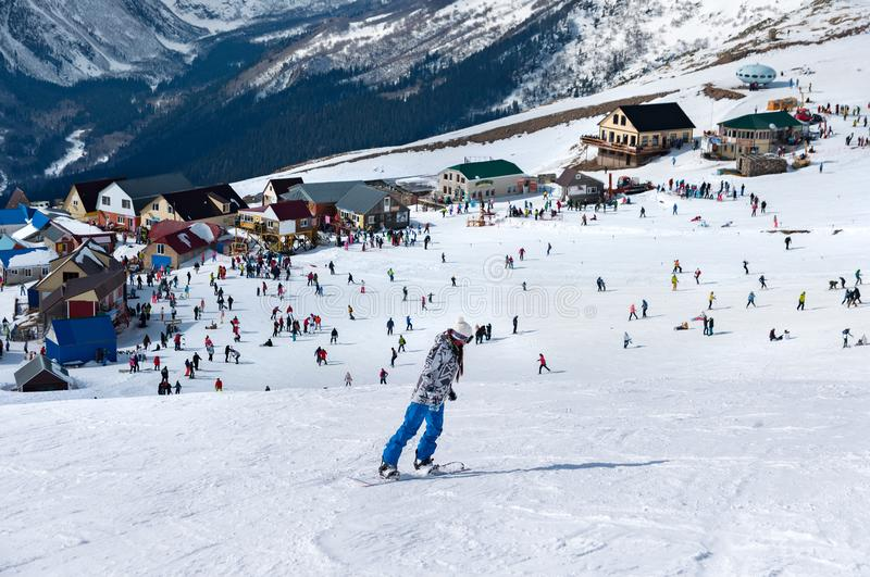 Modern ski resort in mountains. Dombai, Russia. Skier skiing downhill in high mountains stock photography