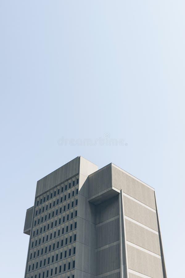 Modern skyscraper against blue skies stock image