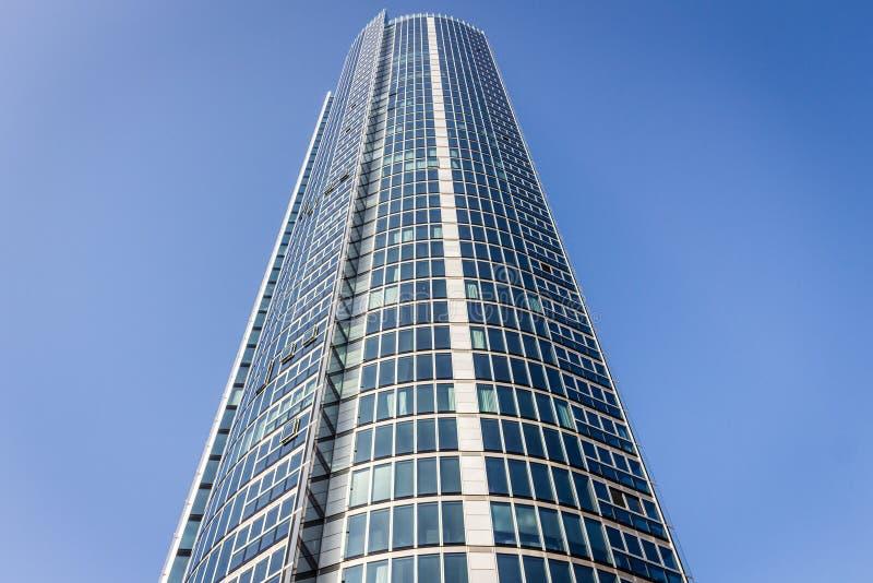 Modern skyscraper against blue skies stock photo