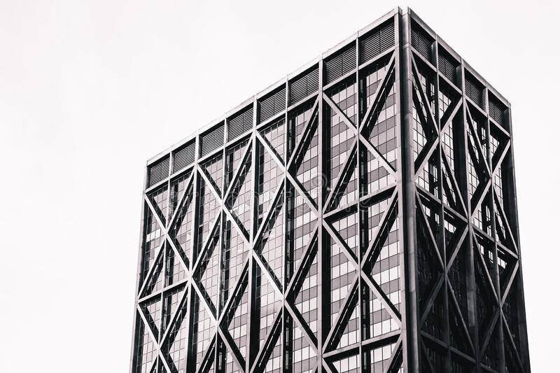 High-rise office building, black and white. Modern skyscraper. High-rise glass building exterior. Black and white vintage stylized with grain royalty free stock photos