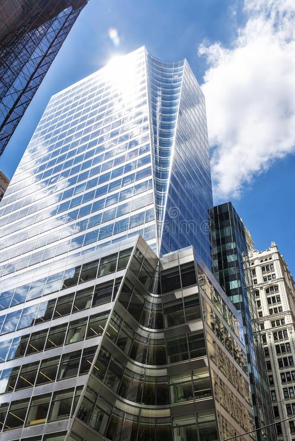 Modern skyscrapers in Manhattan, New York City, USA. Low angle shot of modern skyscrapers and a sunbeam in Manhattan, New York City, USA royalty free stock photography