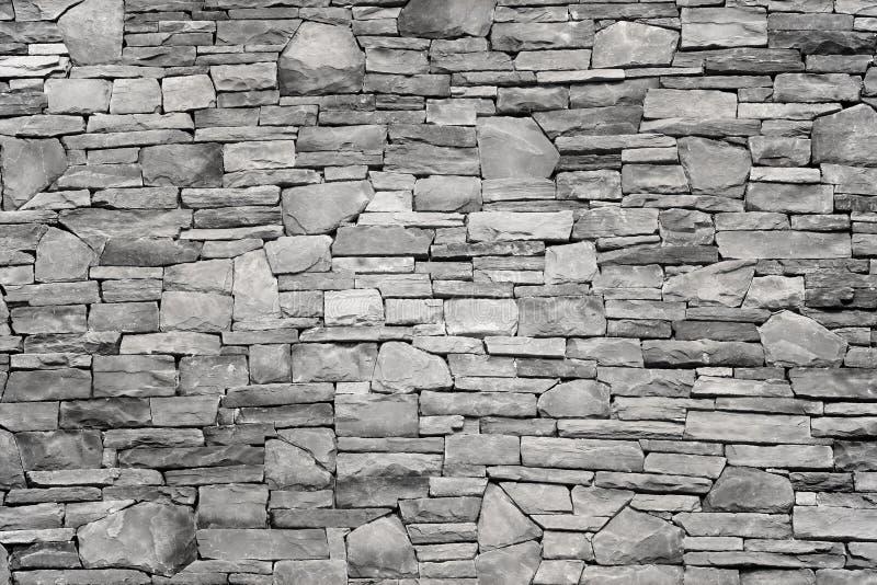Modern slab ,slat stone wall. Background royalty free stock image