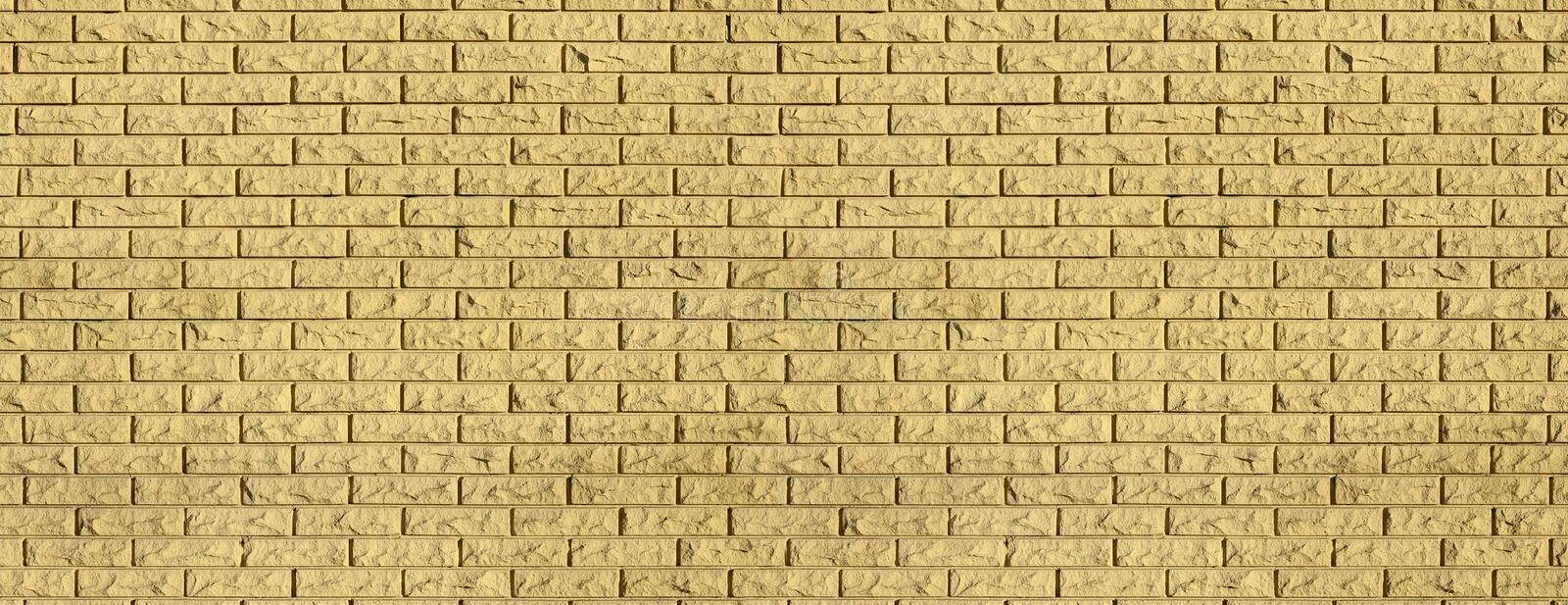 Modern slate brick wall texture. The texture of the walls of the modern high-quality stone brick. Smooth texture brick wall in bright sunlight in the daytime in royalty free stock image