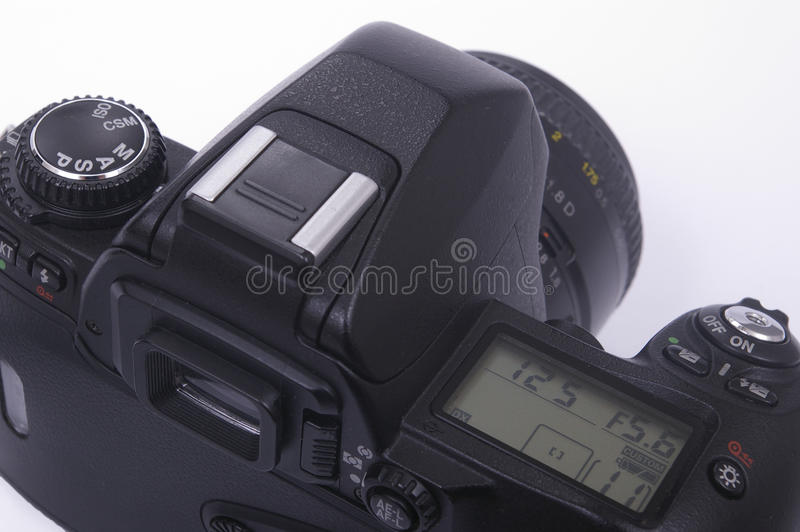 Modern SLR camera. With 50mm lens fitted royalty free stock photography