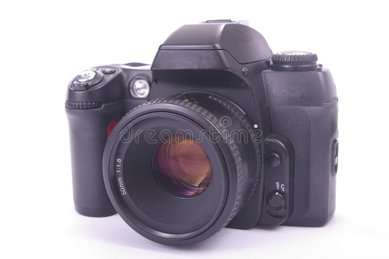 Modern SLR camera. With 50mm auto focus lens fitted stock image