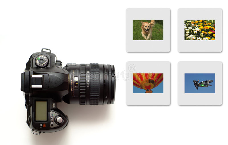 Modern slr camera isolated with colour slides royalty free stock photo