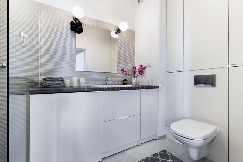 Modern small bathroom in stylish apartment royalty free stock images