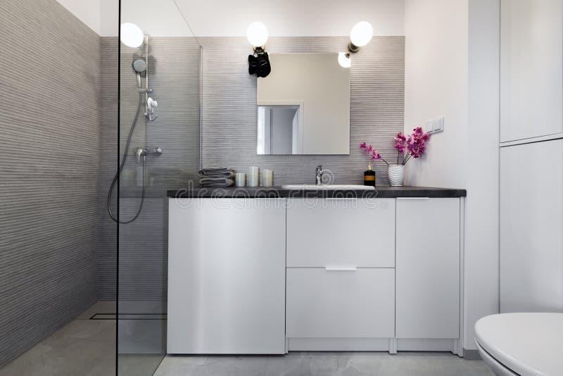 Modern small bathroom in stylish apartment stock image