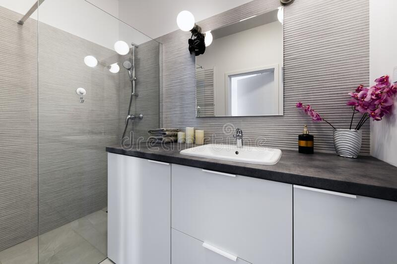 Modern small bathroom in stylish apartment royalty free stock image