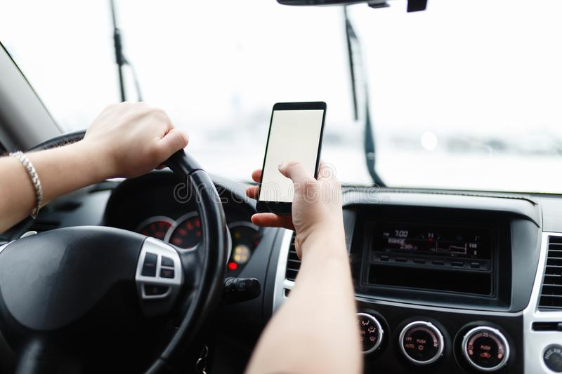 Modern smartphone with blank screen with copy space for your text or design, close-up of male driver hands using mobile phone in l. Frontal view of modern stock image