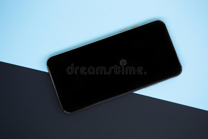 Modern smartphone device with empty screen for app logo stock photography