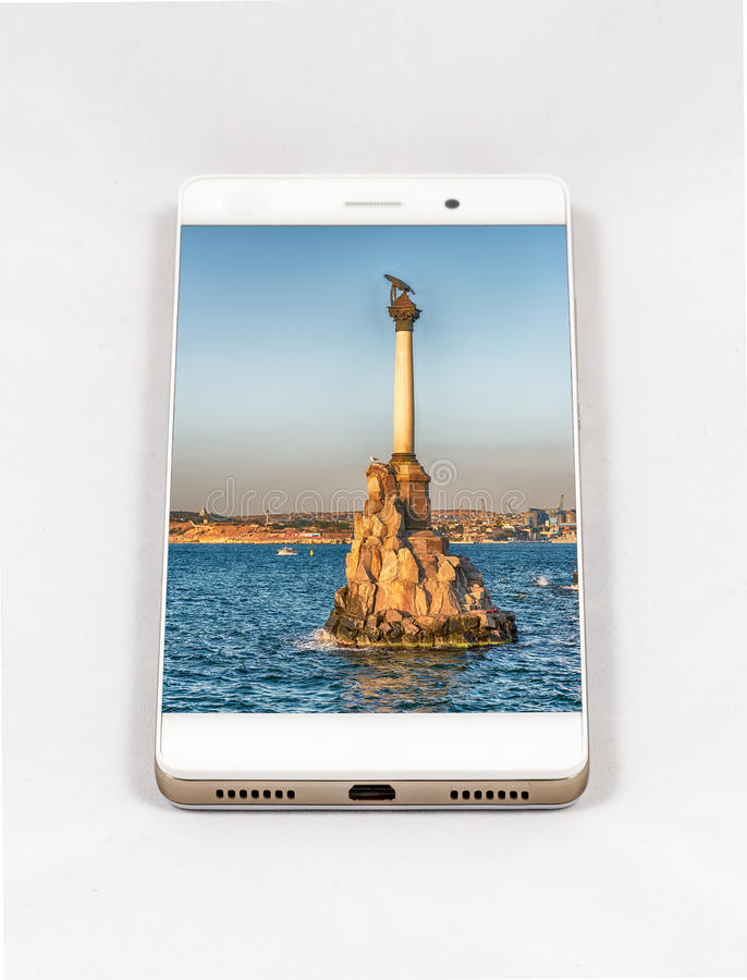 Modern smartphone displaying picture of Sevastopol, Crimea royalty free stock image
