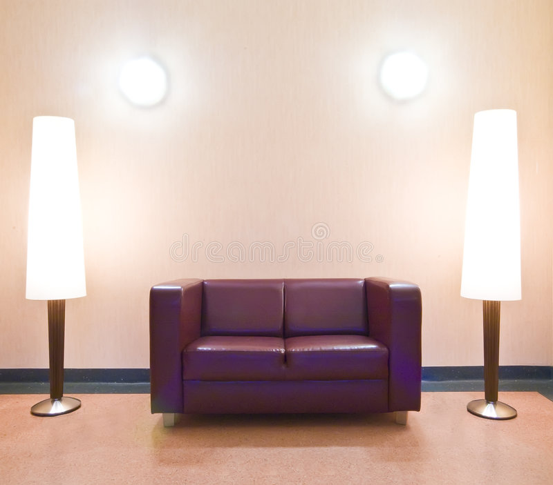 Modern sofa and floor lamps stock images