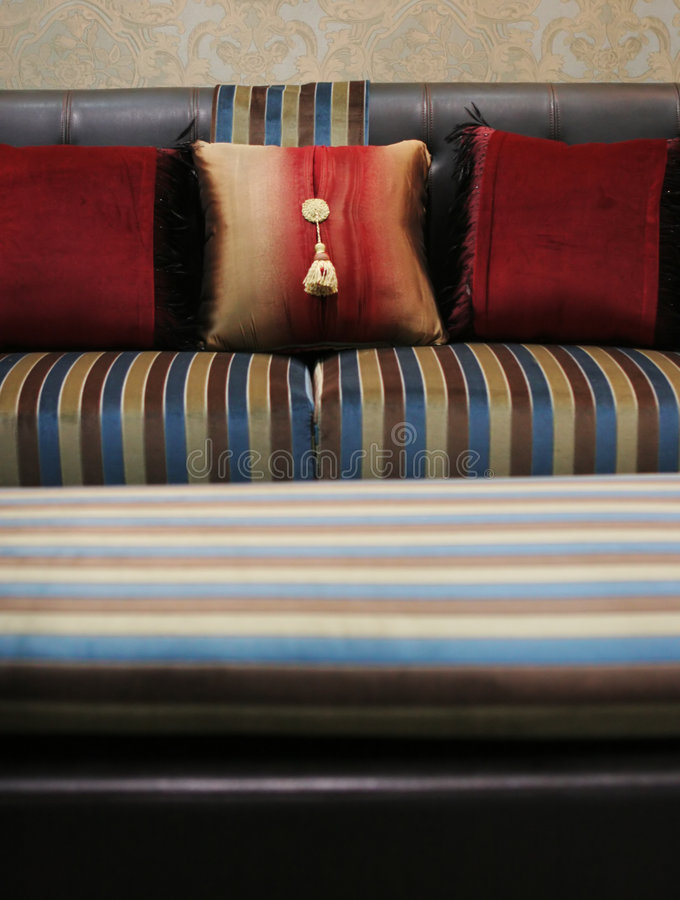 Modern sofa with pillows royalty free stock photo