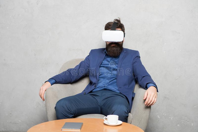 Modern software for business. Business implement modern technology. Businessman sit chair wear hmd explore virtual. Reality or ar. Business partner interact in royalty free stock images