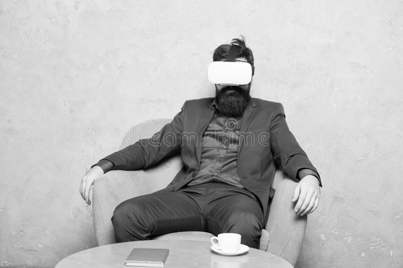 Modern software for business. Business implement modern technology. Businessman sit chair wear hmd explore virtual. Reality or ar. Business partner interact in stock photos