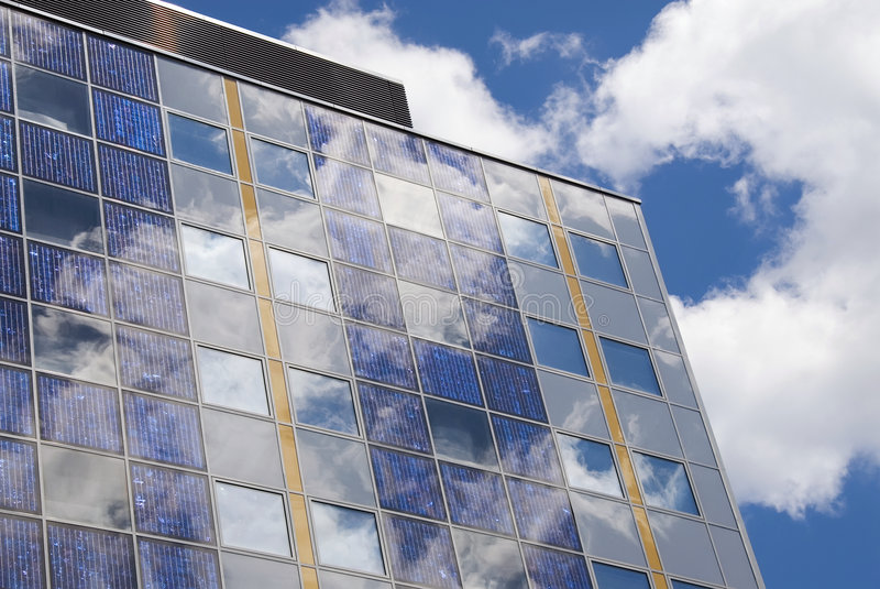 Modern solar cell at a facade. A solar cell or photovoltaic cell is a device that converts light energy into electrical energy. Sometimes the term solar cell is royalty free stock images