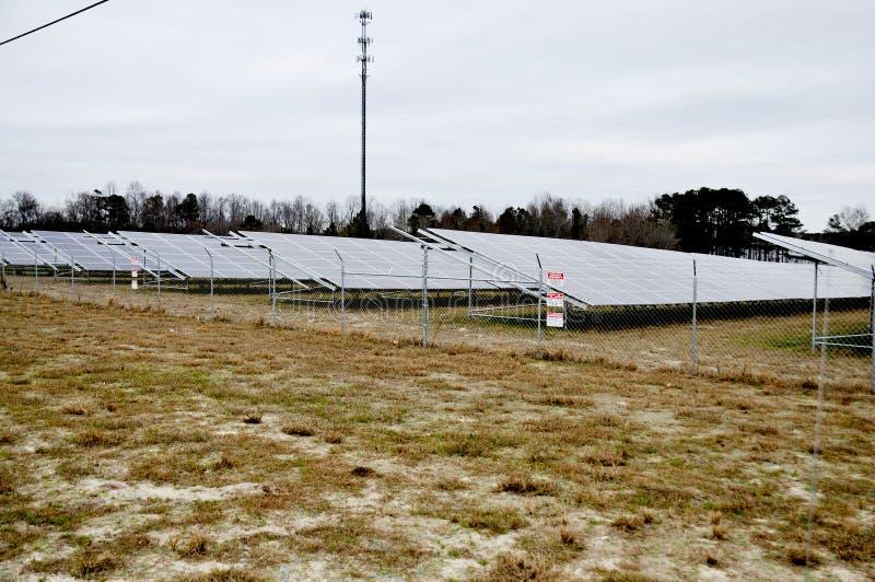 Modern Solar Farm. Series of solar panels in a huge field stock image