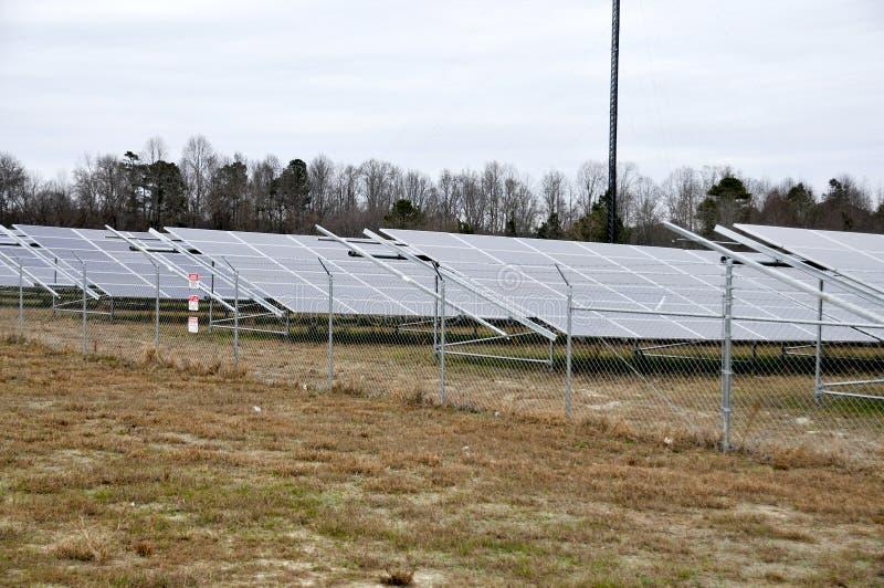 Modern Solar Farm. Series of solar panels in a huge field stock photos