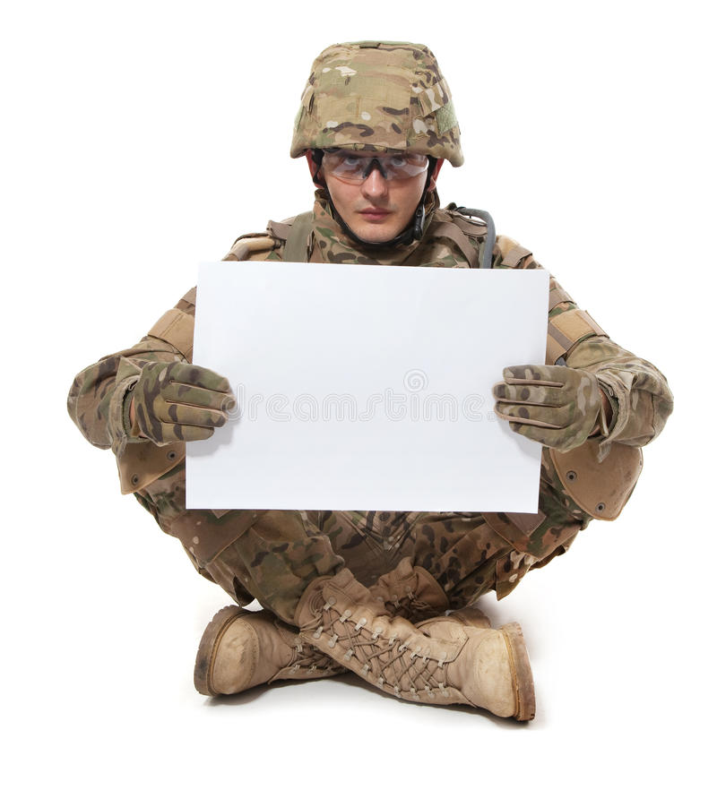 Modern soldier holding a poster royalty free stock images