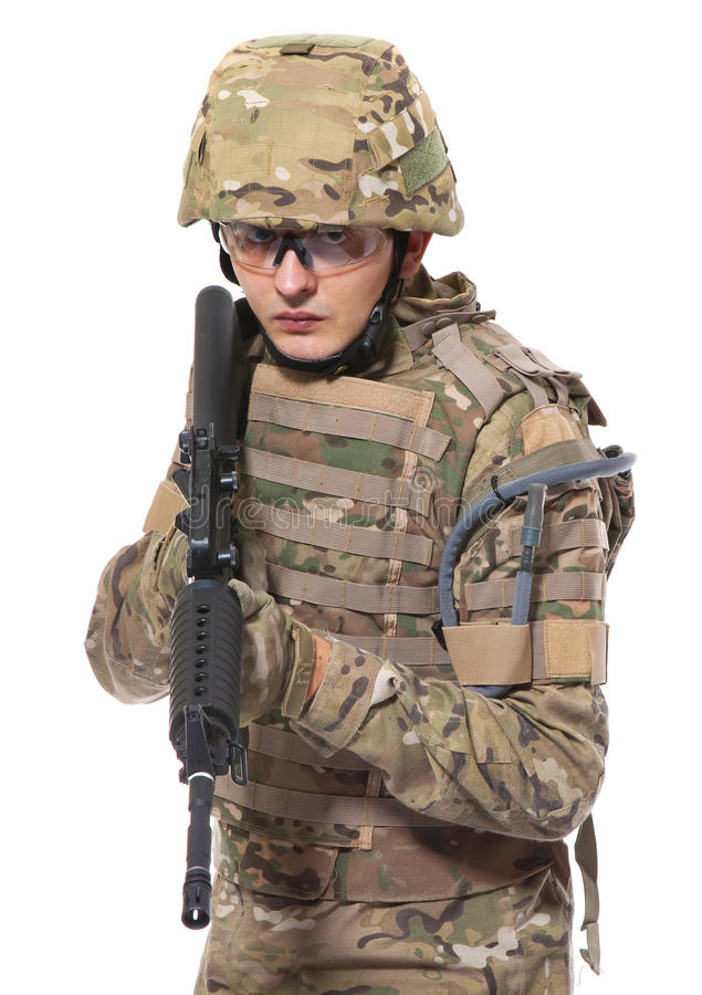 Modern soldier with rifle royalty free stock photography