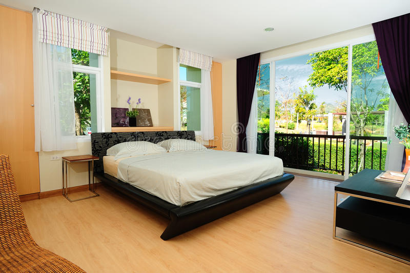 Modern Spacious Bedroom stock images