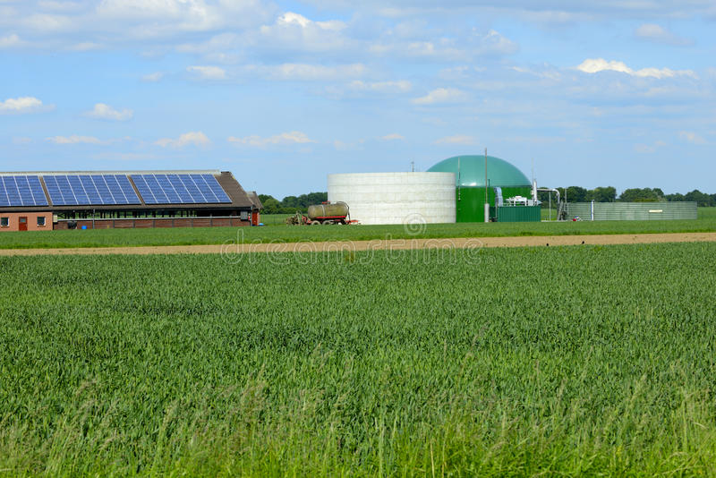 Modern stable with biogas and solar stock images