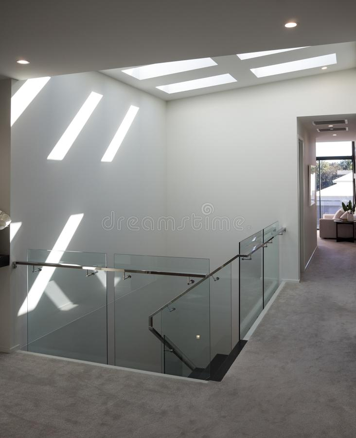 Modern staircase with bright sunlight through ceiling windows royalty free stock photos