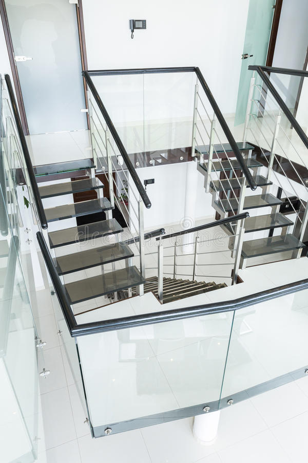 Modern staircase at home. Vertical view of modern staircase at home stock photo