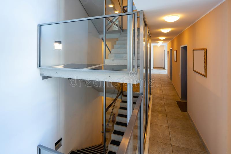 Modern stairs with glass parapet in modern condominium royalty free stock photos