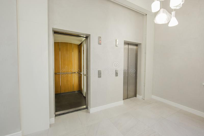 Modern steel elevator cabins in the business lounge or hotel, shop, salon, office, widescreen in perspective. stock image