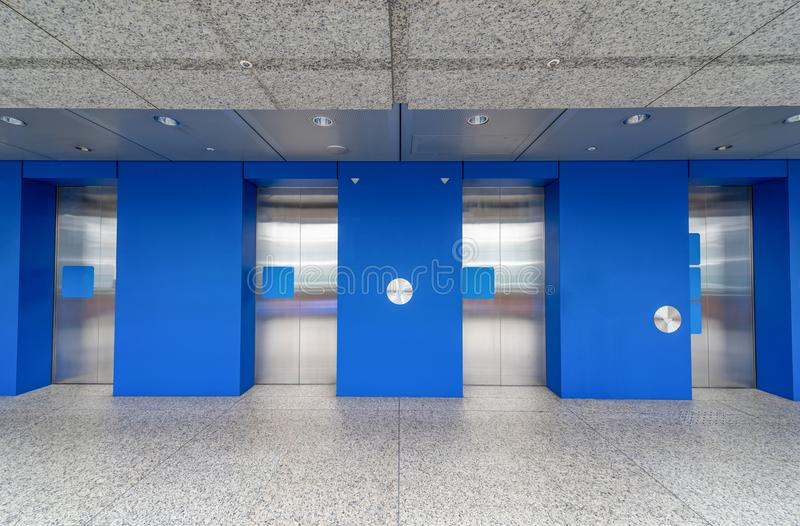 Modern steel elevator cabins in a lobby Hotel or office building stock photos