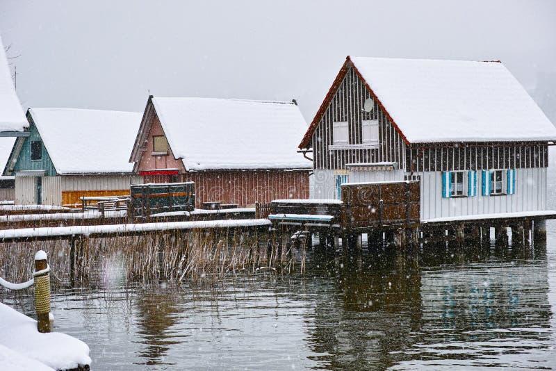 Stilt houses in winter by snow flurry stock image