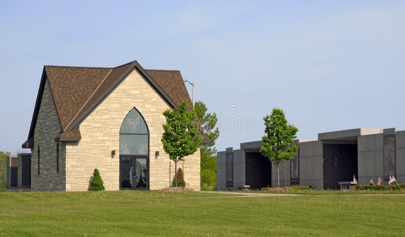Modern Stone Mausoleum. A modern cut stone Mausoleum with etched glass windows stock photo