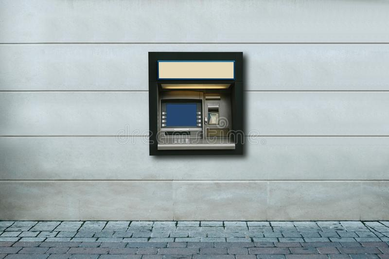 Modern street ATM machine for withdrawal of money and other financial transactions.  royalty free stock image