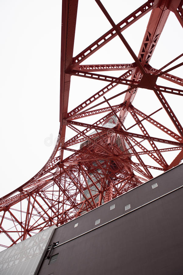 Modern structure in Japan. In the picture we can see a red colored tower which is either radio or telecommunication tower stock photography