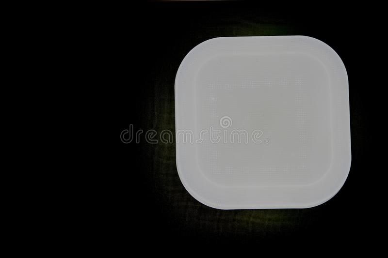 Modern style background for a monitor. grey square with beveled corners on black background. The bottom view image of the. Grey square with beveled corners on stock photography