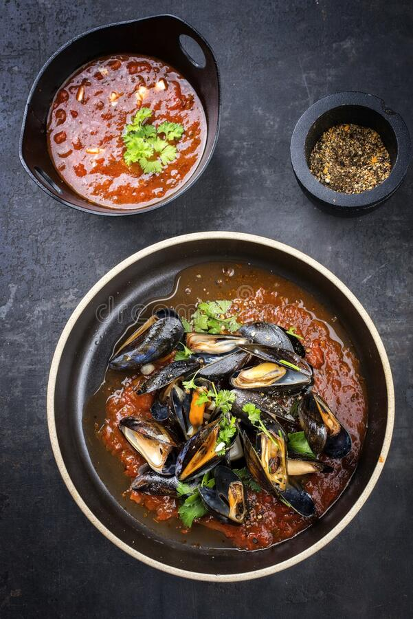 Free Modern Style Barbecue Italian Blue Mussel In Tomato Sauce With Parsley And Garlic In Red Wine Sauce On Modern Nordic Design Plate Royalty Free Stock Image - 191833676